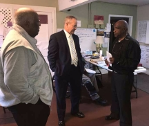 Mayor Talley, Fred Williams of Synovus Bank, and Rev Johnson